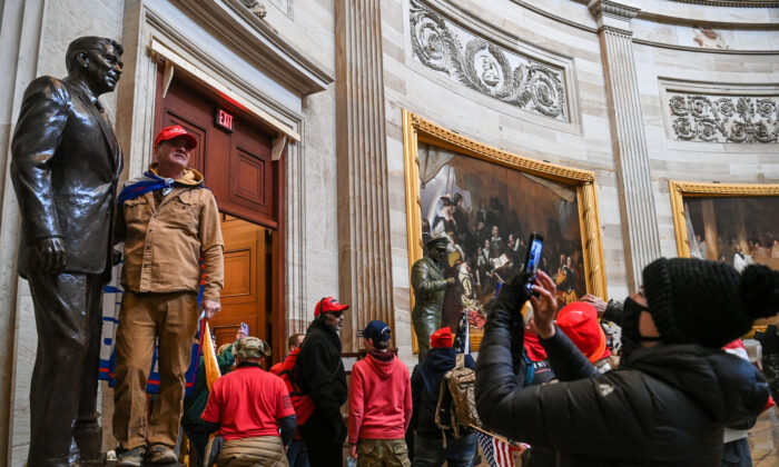 A group of protesters enter the U.S. Capitol Rotunda in Washington, on Jan. 6, 2021. (Saul Loeb/AFP via Getty Images)