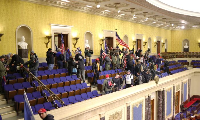 A group of protesters enter the Senate Chamber in Washington on Jan. 6, 2021. (Win McNamee/Getty Images)