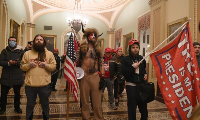 A group of protesters enter the U.S. Capitol in Washington on Jan. 6, 2021. (Saul Loeb/AFP via Getty Images)