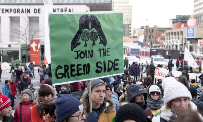 "People attend a climate change demonstration in Montreal on Dec. 8, 2018. The mantra to build a ""green economy"" is actually code to kill the oil and natural gas industry replace it with solar and wind power, battery-powered cars, and the like. (The Canadian Press/Graham Hughes)"