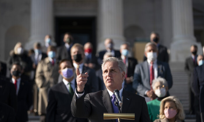 House Minority Leader Kevin McCarthy (R-Calif.), surrounded fellow House Republicans, speaks during a news conference outside the U.S. Capitol in Washington on Dec. 10, 2020. (Drew Angerer/Getty Images)