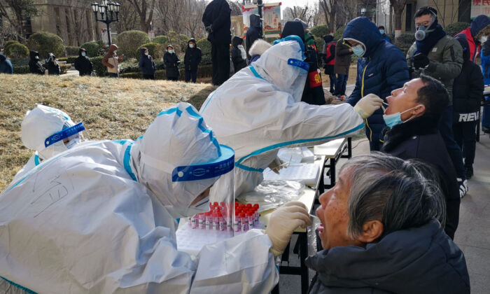 Medical workers are taking swab samples from residents in Shijiazhuang, in northern China's Hebei Province on Jan. 6, 2021. (STR/CNS/AFP via Getty Images)