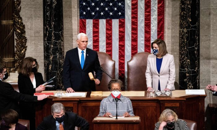 Vice President Mike Pence and House Speaker Nancy Pelosi (D-Calif.) preside over a Joint session of Congress to certify the 2020 Electoral College results after protestors stormed the Capitol earlier in the day in Washington on Jan. 6, 2020. (Erin Schaff/Pool/AFP via Getty Images)