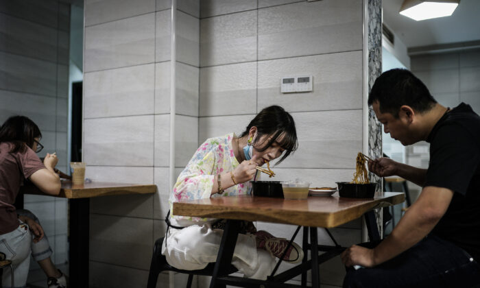 People eat noodles in a restaurant in Wuhan city, Hubei Province, China, on Sept. 16, 2020. (Getty Images)