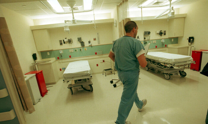 An emergency room nurse walks through the Clinical Decision Unit at the newly-opened Berenson Emergency Department at Beth Israel Deaconess Medical Center in Boston on July 16, 2001. (Darren McCollester/Getty Images)