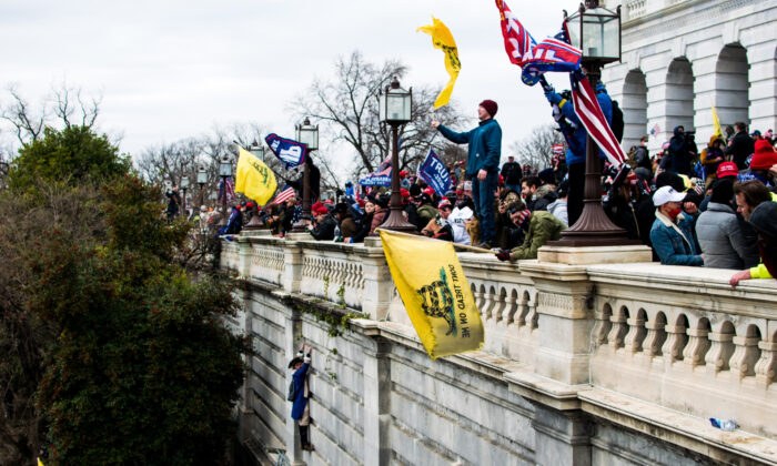 Protesters stand on the veranda of the U.S. Capitol at a rally in Washington on Jan. 6, 2021. (Courtesy of Brandon Drey)