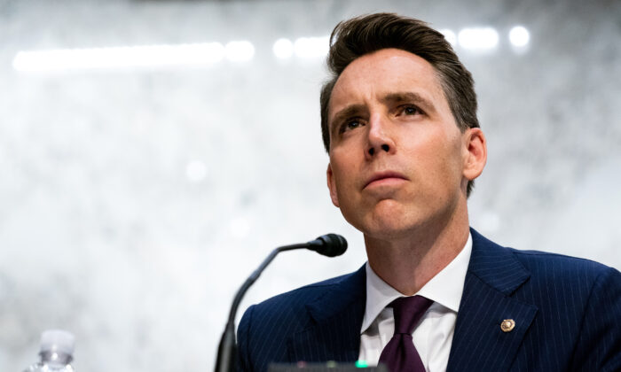 Sen. Josh Hawley (R-Mo.) listens while Supreme Court nominee Judge Amy Coney Barrett testifies before the Senate Judiciary Committee on the second day of her Supreme Court confirmation hearing on Capitol Hill in Washington, on Oct. 13, 2020. (Anna Moneymaker-Pool/Getty Images)