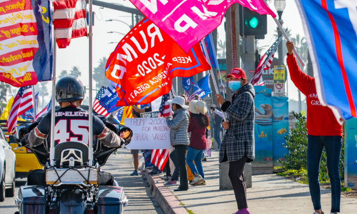 Demonstrators partake in a Stop The Steal Rally, in Huntington Beach, Calif., on Jan 6, 2021. (John Fredricks/The Epoch Times)