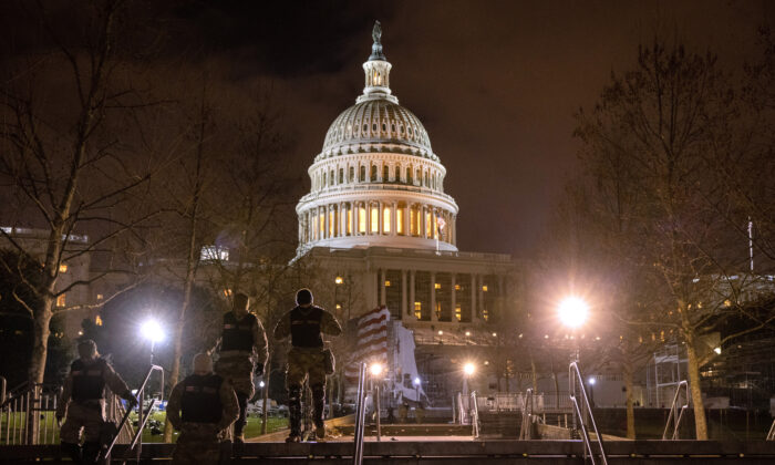 National Guard troops walk through the grounds of the U.S. Capitol in Washington, on Jan. 6, 2021. (John Moore/Getty Images)