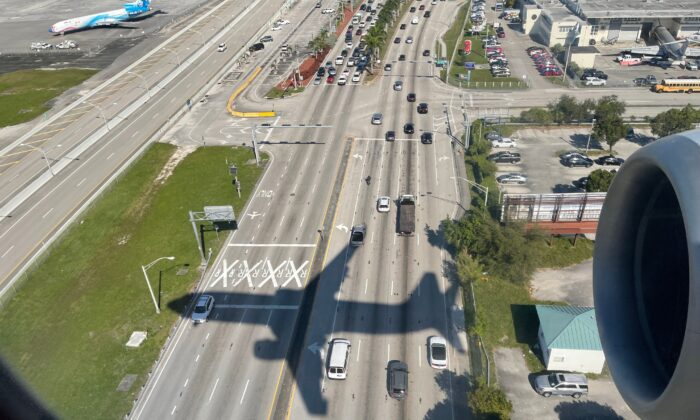 The shadow of an airplane on Highway 953 in Miami on Dec. 18, 2020. (Daniel Slim/AFP via Getty Images)
