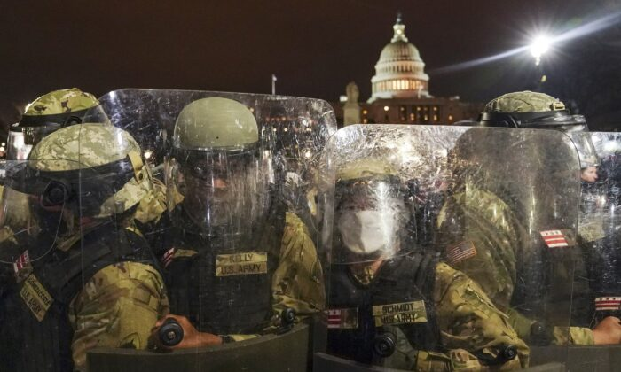 DC National Guard personnel stand outside the U.S. Capitol in Washington on Jan. 6, 2021. (John Minchillo/AP Photo)