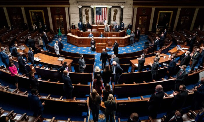 Electoral College votes are brought in before House Speaker Nancy Pelos (D-Calif.) and Vice President Mike Pence esume presiding over a Joint session of Congress to certify the 2020 Electoral College results, in Washington on Jan. 6, 2021. (Erin Schaff/Pool/AFP via Getty Images)