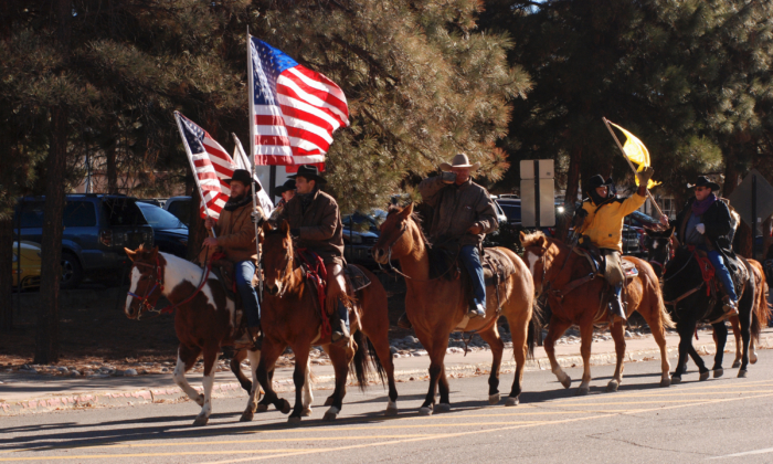 Protesters who back President Donald Trump massed at the the Statehouse in Santa Fe, N.M., on Wednesday, Jan. 6, 2021. (AP Photo/Morgan Lee)