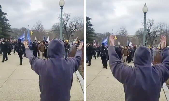 An unidentified individual waves protesters through open barricades into the Capitol grounds, as police stand back, in Washington on Jan. 6, 2021. (Screenshot of video by Unjungbits ONLY)