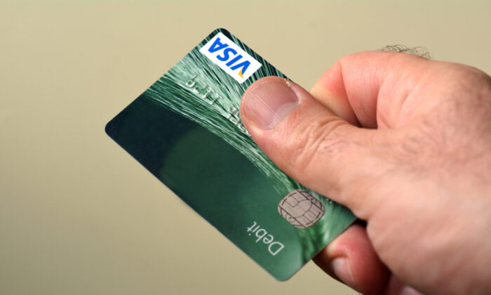 For you, a debit card is a convenience. For your bank, it's a huge moneymaker. (ChameleonsEye/Shutterstock)