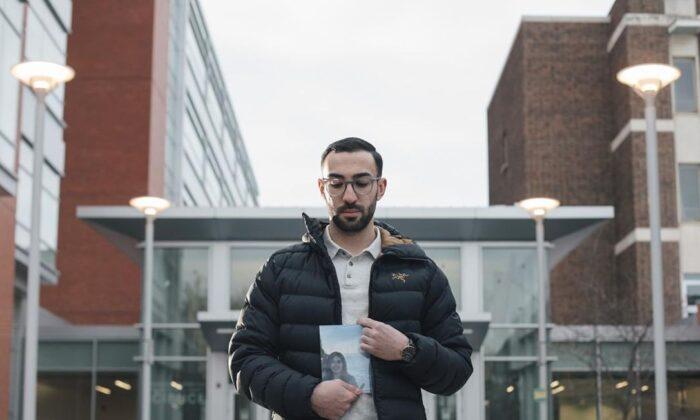 Daniel Ghods holds a photo of his girlfriend Saba Saadat, who died in the crash of Ukraine International Airlines Flight 752, in Edmonton on Dec. 31, 2020. (The Canadian Press/Amber Bracken)