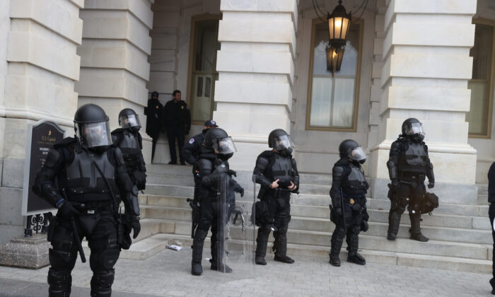Capitol police officers stand guard as protesters gather on the U.S. Capitol Building in Washington on Jan. 6, 2021. (Tasos Katopodis/Getty Images)