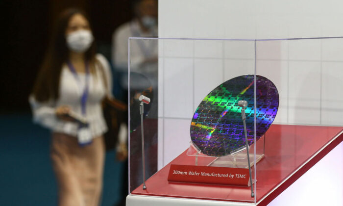 A chip by Taiwan Semiconductor Manufacturing Company (TSMC) is seen at the 2020 World Semiconductor Conference in Nanjing in coastal China's Jiangsu Province on Aug. 26, 2020. (STR/AFP via Getty Images)