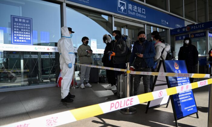 Passengers being stopped at the entrance of a railway station as the city cuts outside transport links and bans residents from leaving, after the large COVID-19 outbreak in Shijiazhuang, in northern China's Hebei Province on Jan. 7, 2021. (STR/CNS/AFP via Getty Images)