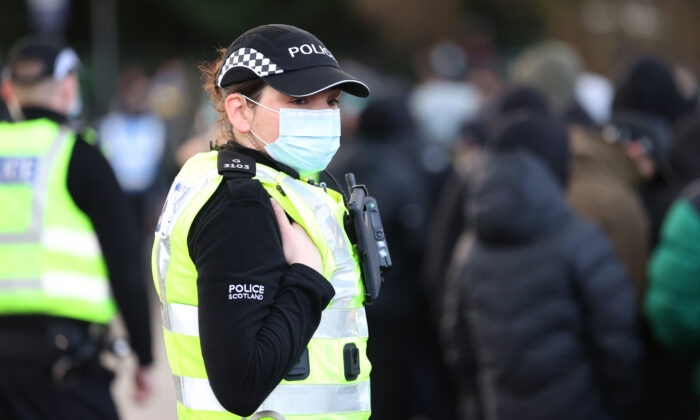 In this file image, a police officer stands at Hampden Park National Stadium in Glasgow, Scotland, on Dec. 20, 2020.  (Ian MacNicol/Getty Images)