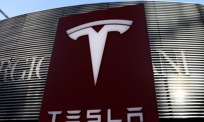 A logo of the electric vehicle maker Tesla is seen near a shopping complex in Beijing, China, on Jan. 5, 2021. (Tingshu Wang/Reuters)
