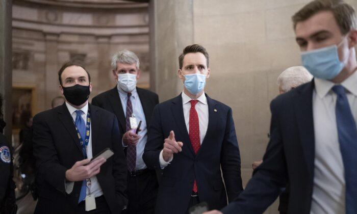 Sen. Josh Hawley (R-Mo.) walks to the House Chamber in Washington on Jan. 6, 2021. (Scott Applewhite/AP Photo)