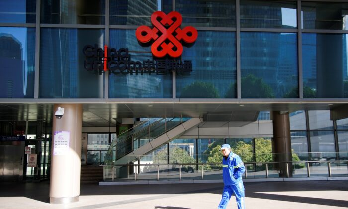A sign of China Unicom is seen on a street, during the COVID-19 pandemic in Shanghai, China, on Jan. 8, 2021. (Aly Song/Reuters)