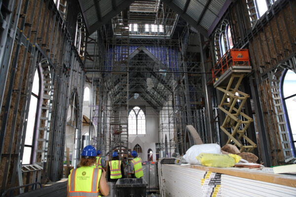 the steel framework underneath the wood paneling of Christ the King Chapel