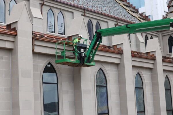 working on the exterior of Christ the King Chapel