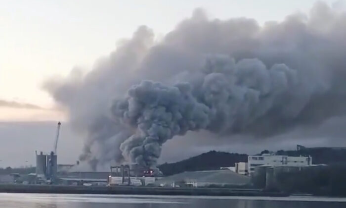 A still image taken from a video obtained from social media shows smoke billows after a large fire broke out at the southern Irish port of Cork on Jan. 9, 2021. (@YAYCORK/via Reuters)