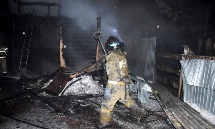 Firefighters work at the site of fire of a nursing home in the town of Borovsky, western Siberia, Russia, on Jan. 9, 2021. (Russian Ministry of Emergency Situations press service via AP)