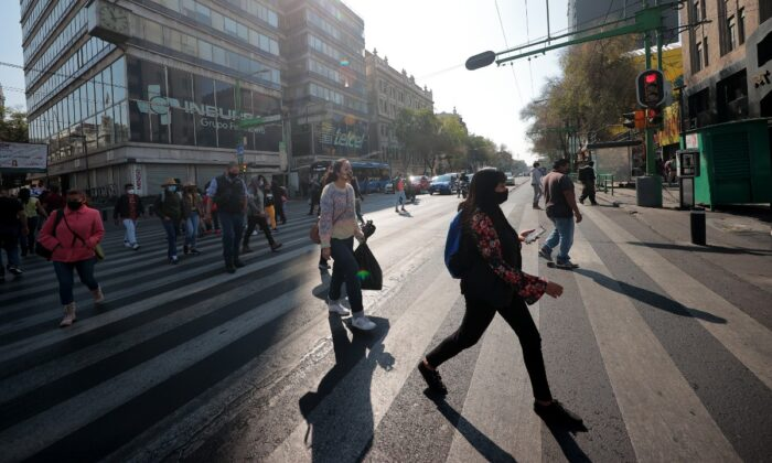People walk in the streets of downtown Mexico City, Mexico, on Dec. 19, 2020. (Hector Vivas/Getty Images)