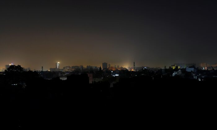 A general view of a residential area is seen during a power breakdown in Karachi, Pakistan, on Jan. 10, 2021. (Akhtar Soomro/Reuters)