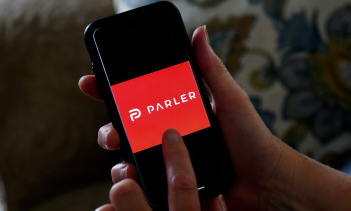 "This illustration picture shows social media application logo from Parler displayed on a smartphone in Arlington, Virginia on July 2, 2020. - Amid rising turmoil in social media, recently formed social network Parler is gaining with prominent political conservatives who claim their voices are being silenced by Silicon Valley giants. Parler, founded in Nevada in 2018, bills itself as an alternative to ""ideological suppression"" at other social networks. (Olivier DOULIERY/AFP via Getty Images)"