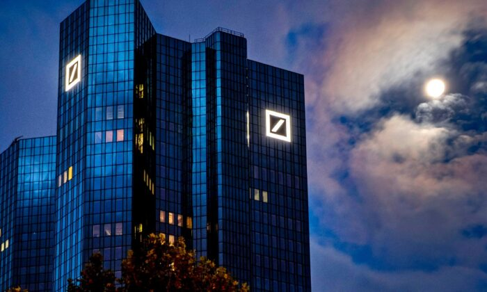 The moon shines next to the headquarters of the Deutsche Bank in Frankfurt, Germany, on Oct. 4, 2020. (Michael Probst/AP Photo, File)