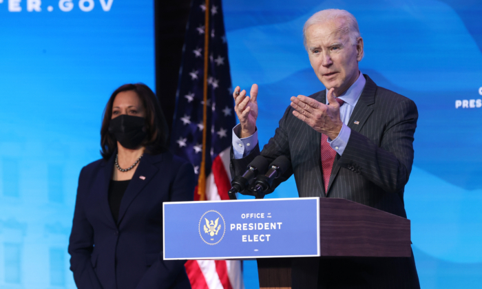 Vice President-elect Kamala Harris (L) looks on as President-elect Joe Biden (R) delivers remarks after he announced cabinet nominees that will round out his economic team, including secretaries of commerce and labor, at The Queen theater in Wilmington, Del., on Jan. 8, 2021. (Chip Somodevilla/Getty Images)