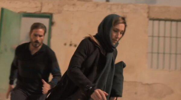 couple running in dark clothes