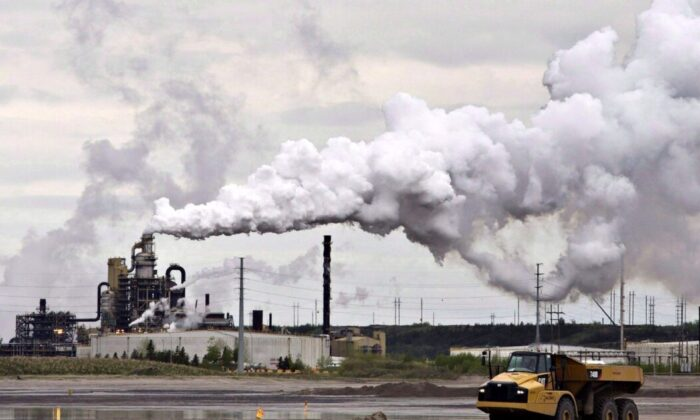 A dump truck works near the Syncrude oilsands extraction facility near Fort McMurray, Alta., in a file photo. (The Canadian Press/Jason Franson)