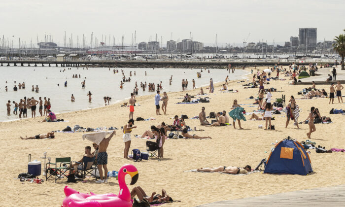 People enjoy the weather at St Kilda beach in Melbourne, Australia on Nov. 27, 2020. (Daniel Pockett/Getty Images)