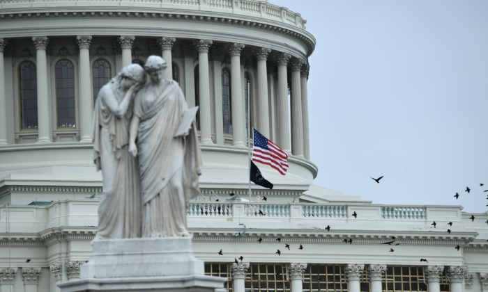 Flags at the US Capitol fly at half-mast to honor US Capitol Police Officer Brian Sicknick, in Washington on Jan. 8, 2021. (Brendon Smialowski/AFP via Getty Images)