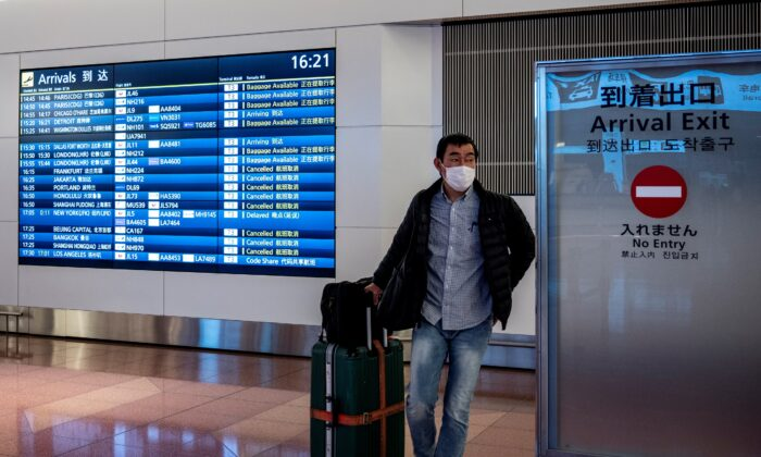 A traveler walks out of the arrivals area at Tokyo's Haneda airport on December 27, 2020. (Philip Fong/AFP via Getty Images)