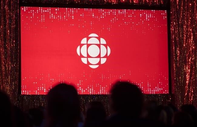 The CBC logo is projected onto a screen in Toronto on May 29, 2019. (The Canadian Press/Tijana Martin)