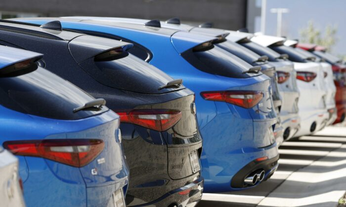 A long row of unsold 2020 Stelvio sports-utility vehicles sits at an Alfa Romeo dealership, in Highlands Ranch, Colo., on July 19, 2020. (David Zalubowski/AP Photo)