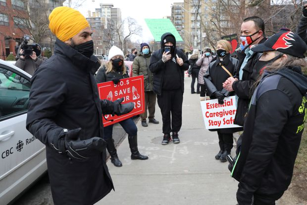 Federal NDP Leader Jagmeet Singh speaks with protesters outside the St. George long-term care home in Toronto during a rally to demand that operator Sienna Senior Living invest more into resident care and staff safety amid the pandemic, on Jan. 10, 2020. (Reuters/Chris Helgren)