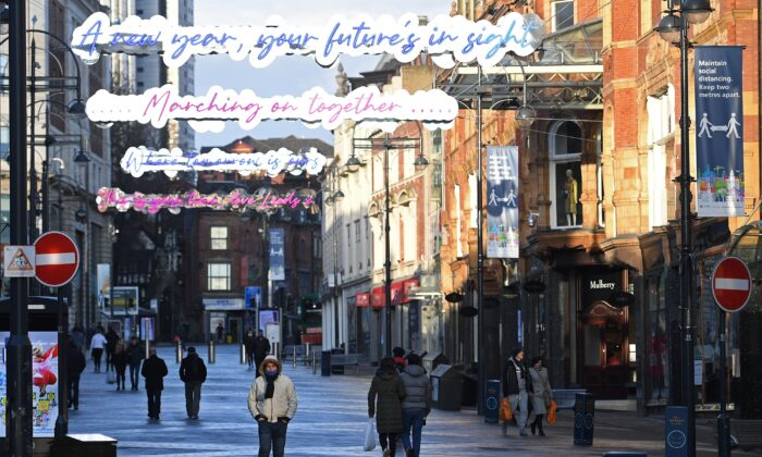 Pedestrians walk along an empty shopping street in Leeds, northern England, on Jan. 6, 2021, on the second day of Britain's national lockdown to combat the spread of COVID-19. (Oli Scarff /AFP via Getty Images)