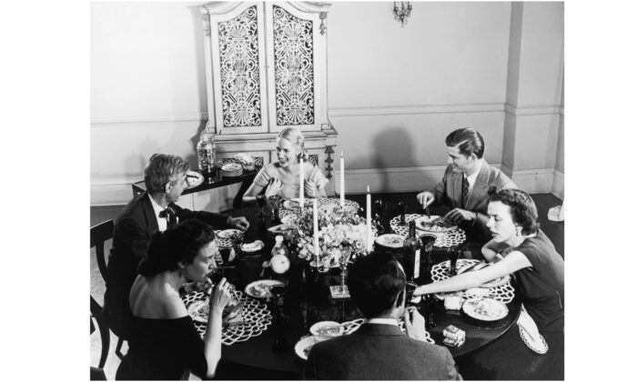 A dinner party, circa 1955. (Hulton Archive/Getty Images)