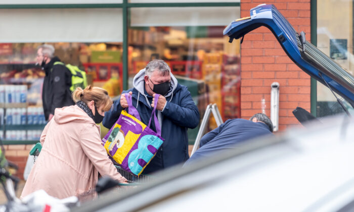 Shoppers outside a branch of Morrisons in Portsmouth, UK, on Dec. 21, 2020. (Andrew Hasson/Getty Images)