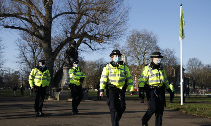 Police maintain a presence at Clapham Common during an anti-lockdown demonstration in London on Jan. 9, 2021. (Hollie Adams/Getty Images)