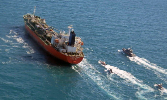 A seized South Korean-flagged tanker is escorted by Iranian Revolutionary Guard boats on the Persian Gulf on Jan. 4, 2021. (Tasnim News Agency via AP, File)