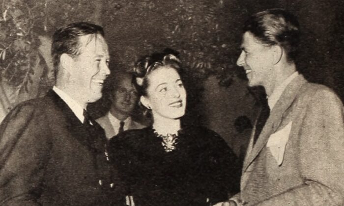 (L–R) Wayne Morris, Eleanor Parker, and Ronald Reagan at a party on the Warner Bros. lot in 1946. (Public Domain)
